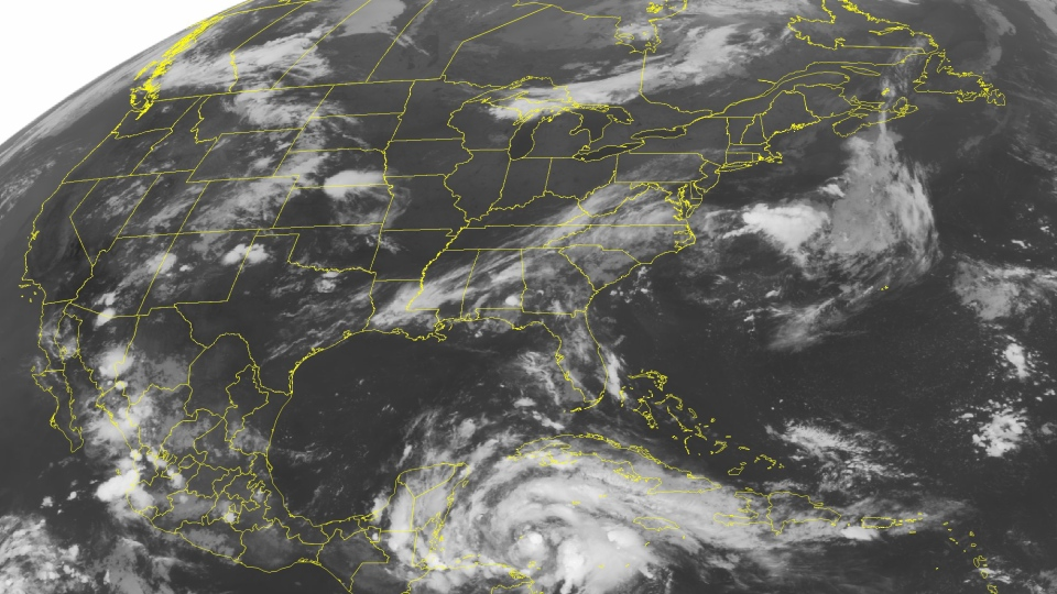 A swirl of clouds are seen in the western Caribbean Sea associated with Tropical Storm Ernesto as it approaches the Yucatan Peninsula, in this NOAA satellite image taken Tuesday, Aug. 7, 2012 at 1:45 a,m, EDT (AP / WEATHER UNDERGROUND)
