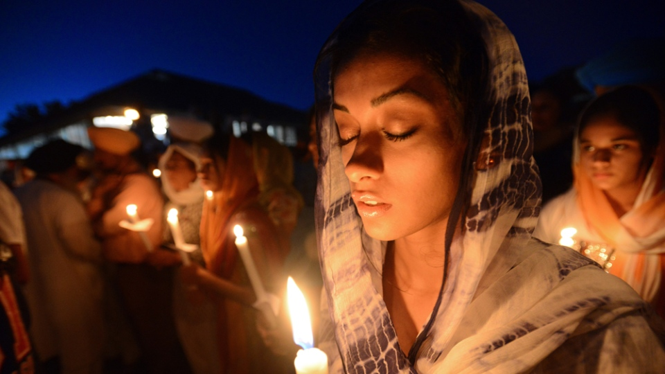 Ruby Singh,22, of Long Grove, Ill., participates during a prayer vigil at the Sikh Religious Society temple in Palatine, Ill. on Monday, Aug. 6, 2012. The vigil was held in memoriam of those killed and wounded in a weekend Sikh temple shooting near Milwaukee. (Daily Herald / Mark Welsh)