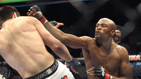 Anderson Silva, left, kicks Chael Sonnen during a Middleweight Championship UFC mixed martial arts match in Oakland, Calif., Saturday, Aug. 7, 2010. (AP / Jeff Chiu)