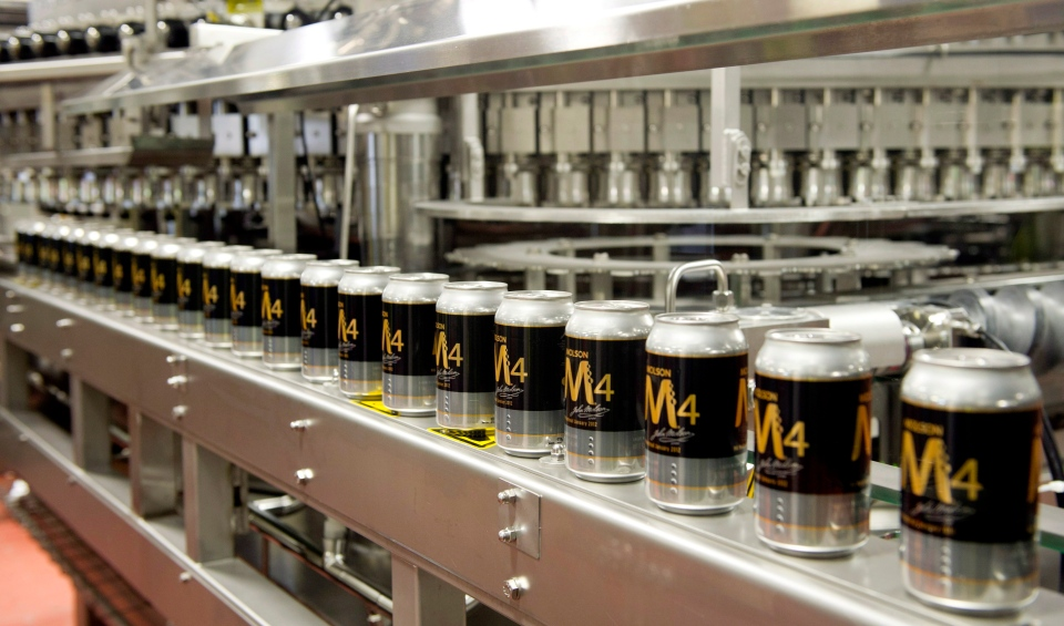 Cans of beer are seen on the Molson Coors can line in Montreal on Monday, March 19, 2012. (Paul Chiasson / THE CANADA PRESS)
