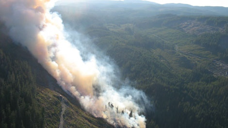 A wildfire blazes near Jordan River on Vancouver Island. Aug. 14, 2010. (B.C. Forest Service)