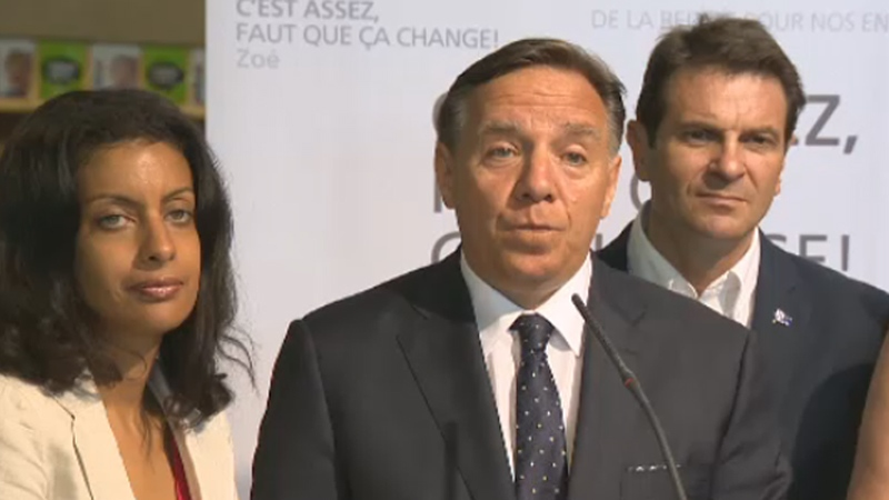 Flanked by candidates Dominique Anglade and Francois Bonnardel, Francois Legault promises to cut taxes by $500 in five years.