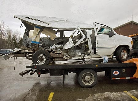 The van that was carrying the Bathurst High School boys' basketball team that collided with a transport truck while returning from a game, rests on a flatbed truck in Bathurst, N.B., on Saturday, Jan. 12, 2008. (THE CANADIAN PRESS/Andrew Vaughan)