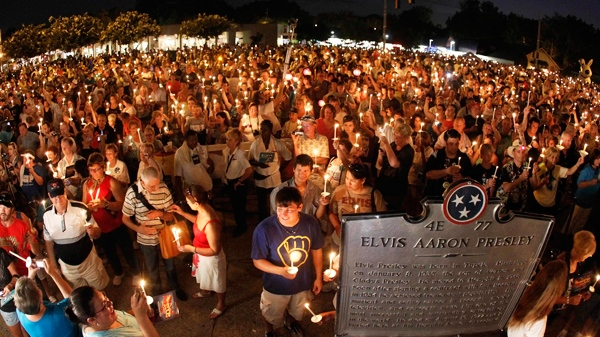 Elvis Presley fans hold candles on Elvis Presley Boulevard outside Graceland, his Memphis, Tenn. home, on Sunday, Aug. 15, 2010. (AP  /Mark Humphrey)