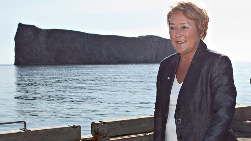 Parti Quebecois Leader Pauline Marois walks on the pier before a news conference during a campaign stop in Perce, Que., on Tuesday, August 7, 2012. (Jacques Boissinot / THE CANADIAN PRESS)