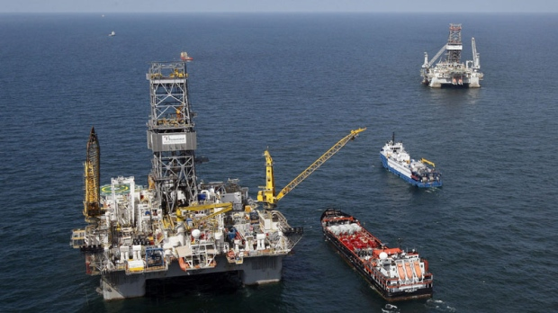 The Transocean Development Driller III, left, and the Transocean Development Driller II, right, the rigs responsible for drilling relief wells at the site of the Deepwater Horizon oil wellhead, are seen on the Gulf of Mexico near the coast of Louisiana, Saturday, Aug. 14, 2010. (AP Photo/Patrick Semansky)