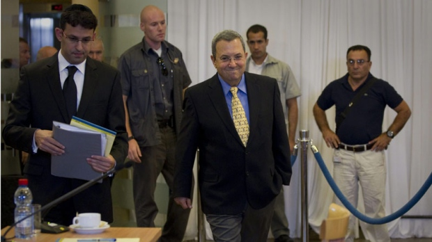 Israeli Defense Minister Ehud Barak, center, arrives to testify in front of a state-appointed inquiry commission into the Israeli naval raid on a Gaza aid flotilla, in Jerusalem, Tuesday, Aug. 10, 2010. (AP Photo/Bernat Armangue, Pool)