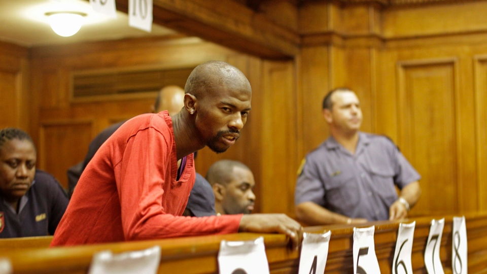 South African Xolile Mngeni, center, stand with Mziwamadoda Qwabe, unseen, in court accused in taking part in the shooting death of Swedish woman Anni Dewani in Cape Town, South Africa, Friday, May 11, 2012. (AP / Schalk van Zuydam)