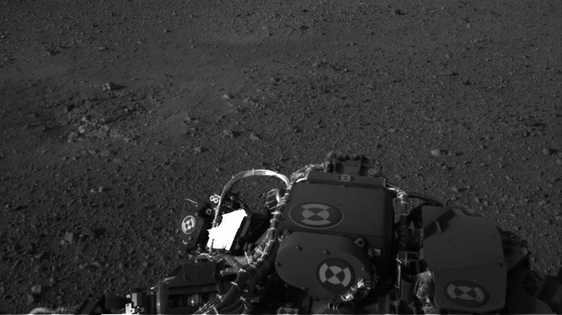 This image released by NASA on Wednesday Aug. 8, 2012 taken by cameras aboard the Curiosity rover shows the surface of Mars.
