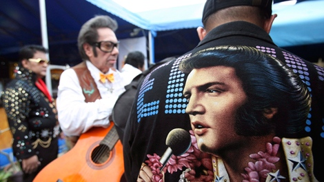 Filipino Elvis Presley impersonators line up to register prior to a performance Sunday, Aug. 15, 2010 in Manila, Philippines to pay tribute to the King of Rock 'n Roll on his 33rd death anniversary. (AP / Bullit Marquez)