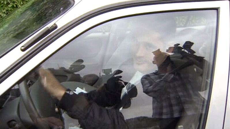 Ryan Lewis is shown after getting into a vehicle in North Vancouver, B.C. on Wednesday, Aug. 8, 2012.