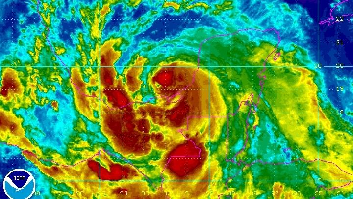 Hurricane Ernesto spins over Mexico's Yucatan Peninsula as seen in this enhanced NOAA satellite image taken 11:15 p.m. ET, Wednesday, Aug. 8, 2012. (NOAA)