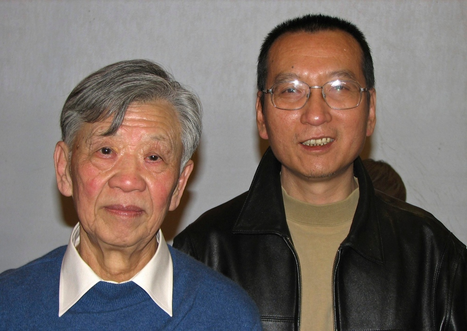 In this photo taken in November, 2007 and released by Liu Xiaobo's friend Friday, Oct. 8, 2010, Liu, right, poses with legal scholar Zhang Sizhi during a gathering in Beijing. (AP Photo)