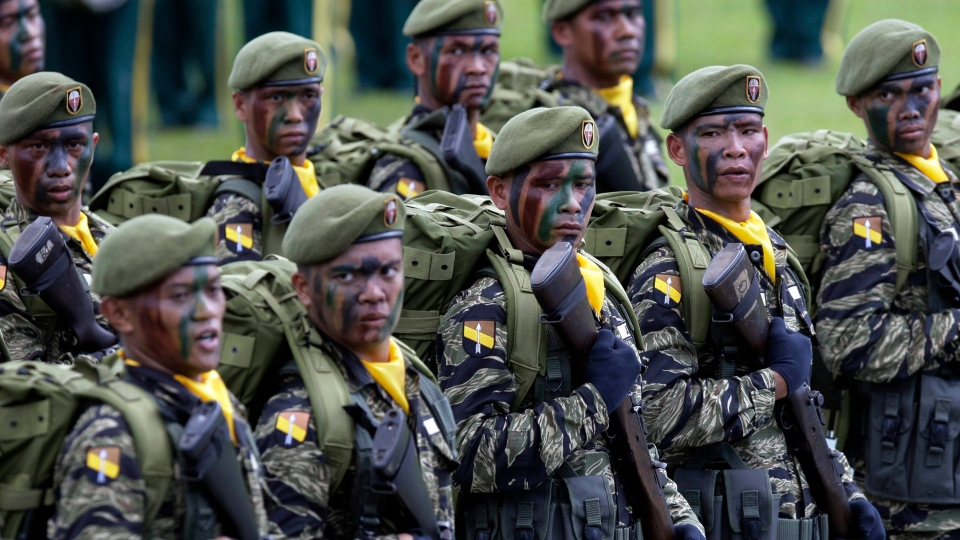 Philippine Army's Special forces march in unison during the passing review after the change of command ceremony Wednesday, Nov. 9, 2011 at the Army headquarters in suburban Taguig City, east of Manila, Philippines. (AP / Pat Roque)