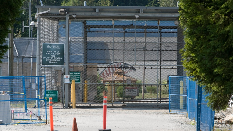 The main gate leading into the Alouette Correctional Centre for Women is seen in Maple Ridge, B.C. Sunday, Aug. 15, 2010. The corrections facility is said to be where some of the 490 migrants who arrived in Canada by ship on Friday are being held. (Jonathan Hayward / THE CANADIAN PRESS)