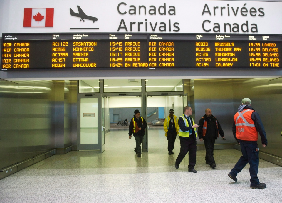 In this file photo, workers are seen at Pearson International Airport in Toronto on Thursday, March 8, 2012. (Nathan Denette / THE CANADIAN PRESS)