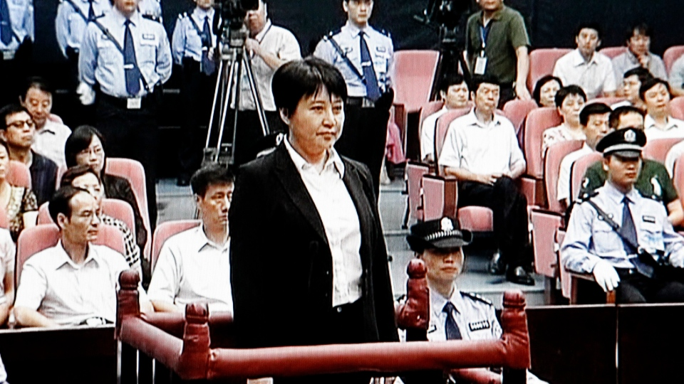 This video image taken from CCTV shows Gu Kailai, centre, the wife of disgraced politician Bo Xilai, standing trial in the Intermediate People's Court in the eastern Chinese city of Hefei, Thursday, Aug. 9, 2012. (AP / CCTV via APTN)