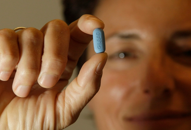 In this Thursday, May 10, 2012 photo, Dr. Lisa Sterman holds up a Truvada pill at her office in San Francisco. Sterman prescribes the drug off-label for about a dozen patients at high risk for developing AIDS. (AP / Jeff Chiu)