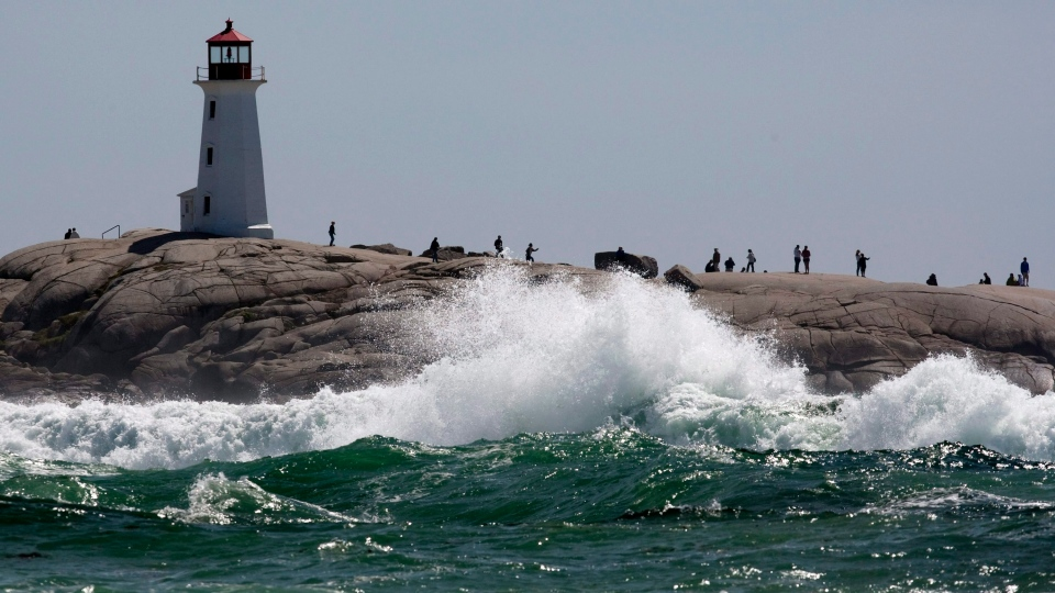 Waves pound the rocks at Peggys Cove, N.S. on Monday, Aug. 29, 2011. (Andrew Vaughan / THE CANADIAN PRESS)