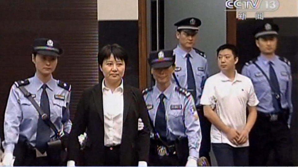 This video image taken from CCTV shows Gu Kailai, second left, the wife of disgraced politician Bo Xilai, being taken into the Intermediate People's Court in the eastern Chinese city of Hefei Thursday Aug. 9, 2012. (AP / CCTV via APTN)