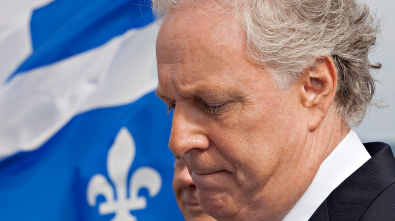 Quebec Liberal Leader Jean Charest ponders a question during a morning news conference in Quebec City on Thursday, August 9, 2012. (Jacques Boissinot / THE CANADIAN PRESS)