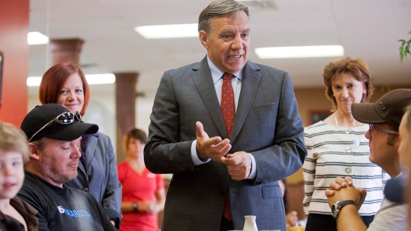 Coalition Avenir Québec leader Francois Legault speaks with members of the public at a cafe during an election campaign stop in Mirabel, Que., Thursday, August 9, 2012. (Graham Hughes / THE CANADIAN PRESS)