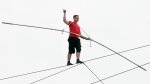 Daredevil Nik Wallenda performs his tightrope walk above the beach in Atlantic City, N.J. Thursday, Aug. 9, 2012. (AP / The Press of Atlantic City, Sean Fitzgerald)