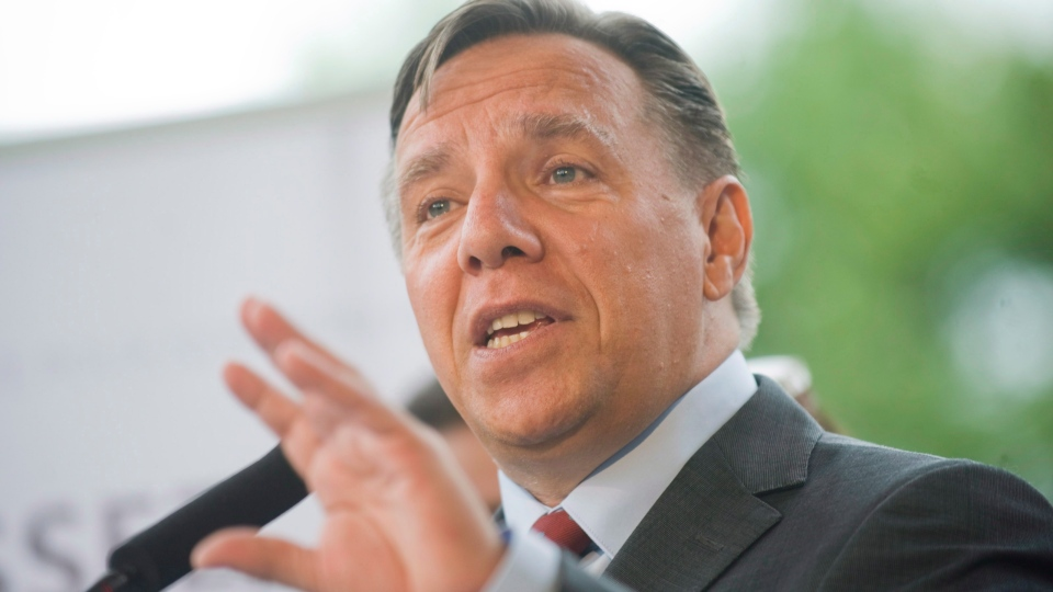 Coalition Avenir Quebec Leader Francois Legault speaks to reporters during an election campaign stop in Mirabel, Que., Thursday, August 9, 2012. (Graham Hughes / THE CANADIAN PRESS)