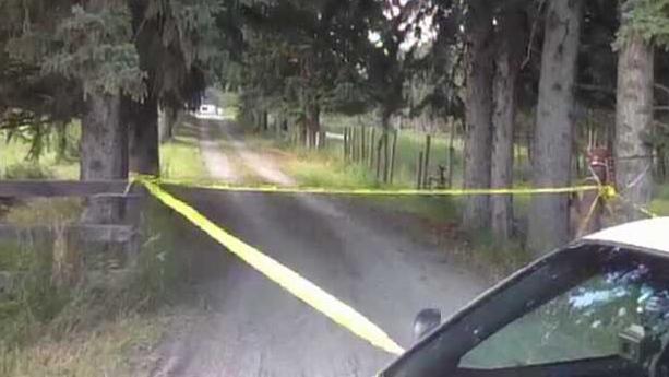 Crime scene tape blocks the driveway at a ranch near Priddis.