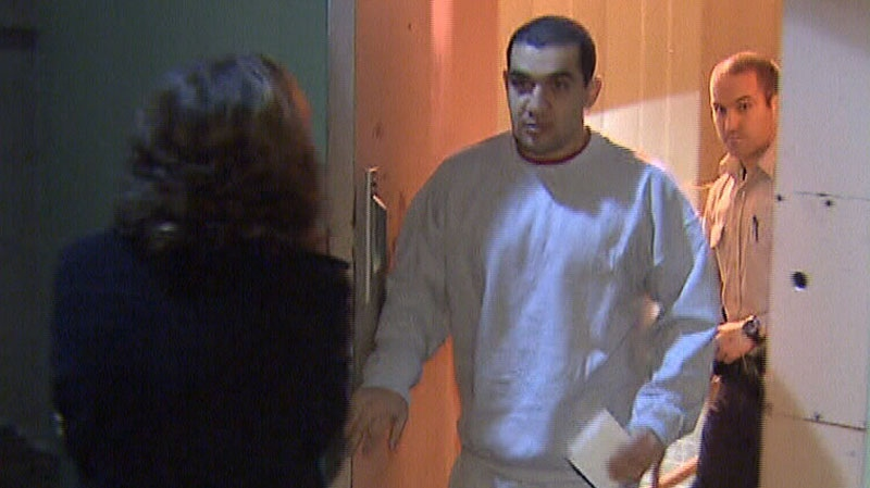 Convicted human trafficker Reza Moazami is seen exiting Vancouver provincial court on Dec. 22, 2011.