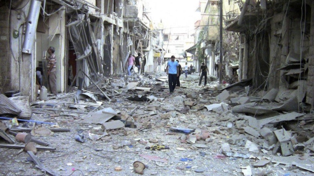 This image made from amateur video purports to show the destruction of houses by shelling from Syrian government forces in Damascus, Syria on Wednesday, Aug. 8, 2012. (Shaam News Network, SSN)