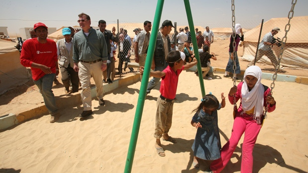 Foreign Affairs Minister John Baird, second left, visits Zaatari camp for Syrian refugees, in Mafraq, Jordan, Saturday, Aug. 11, 2012. (AP / Mohammad Hannon)