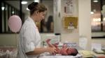 In this Thursday, July 26, 2012 photo, a nurse changes the diaper of a newborn baby at the Perinatal Clinic in Rio de Janeiro, Brazil. (AP / Felipe Dana)