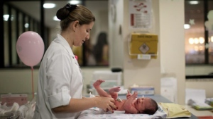 In this Thursday, July 26, 2012 photo, a nurse changes the diaper of a newborn baby at the Perinatal Clinic in Rio de Janeiro, Brazil. (AP / Felipe Dana)