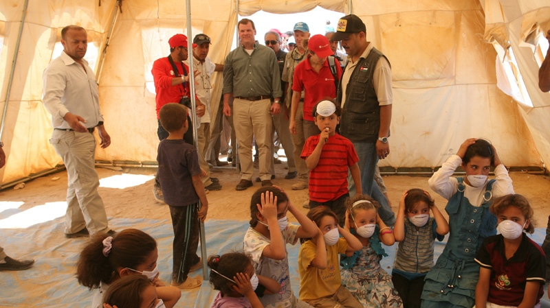 Foreign Affairs Minister John Baird, centre, stops by UNICEF classroom tent during his tour at Zaatari camp for Syrian refugees in Mafraq, Jordan on Saturday, Aug. 11, 2012. (AP / Mohammad Hannon)