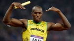 Jamaica's Usain Bolt celebrates his win in the men's 4 x 100-metre relay final during the athletics in the Olympic Stadium at the 2012 Summer Olympics, London, Saturday, Aug. 11, 2012. (Anja Niedringhaus/AP)