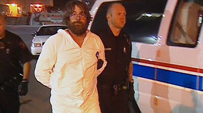 Trevor Kloschinsky, who was charged with first-degree murder in connection with the death of retired RCMP officer Rod Lazenby, is taken into police custody in Calgary on Saturday, Aug. 11, 2012.