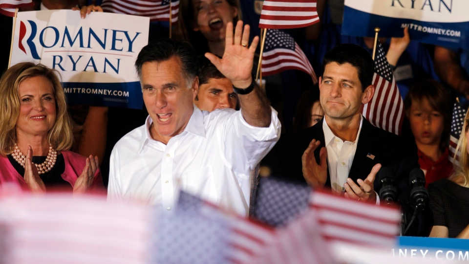 Republican presidential candidate, former Massachusetts Gov. Mitt Romney, centre with his wife Ann, left, and his newly announced vice presidential running mate, Rep. Paul Ryan, R-Wis., right, during a campaign rally in Manassas, Va., Saturday, Aug. 11, 2012. (AP / Pablo Martinez Monsivais)