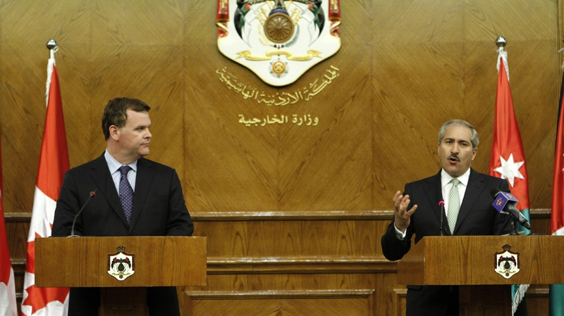 Jordanian Foreign Minister Nasser Judeh, right, and Foreign Affairs Minister John Baird are seen during a press conference following their meeting in Amman, Jordan, Saturday, Aug. 11, 2012. (AP / Raad Adayleh)