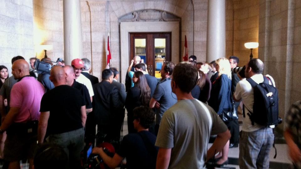 A fake media scrum is set up at the Manitoba legislature on set of the Jack Layton biopic, Smilin' Jack: The Jack Layton Story.