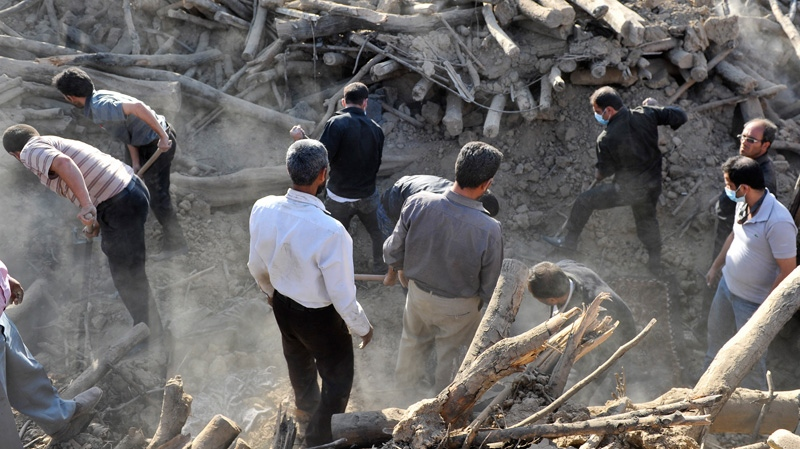 Iranians search the ruins of buildings at the village of Bajebaj near the city of Varzaqan in northwestern Iran, on Sunday, Aug. 12, 2012. (AP / ISNA, Arash Khamoushi)