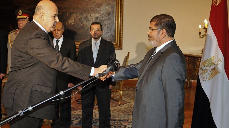 Egyptian President Mohammed Morsi swears in newly-appointed vice president, a former senior judge, Mahmoud Mekki, in Cairo, Egypt on Sunday, Aug. 12, 2012.  (AP / Egyptian Presidency)