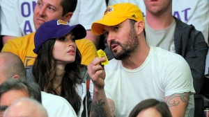 Actress Megan Fox, left, sits with Brian Austin Green as they watch the Los Angeles Lakers play the Denver Nuggets in an NBA first-round playoff basketball game, Sunday, April 29, 2012, in Los Angeles. (AP / Mark J. Terrill)
