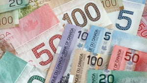 Millionaires in Canada are expected to grow in number by more than half over the next five years. (File)