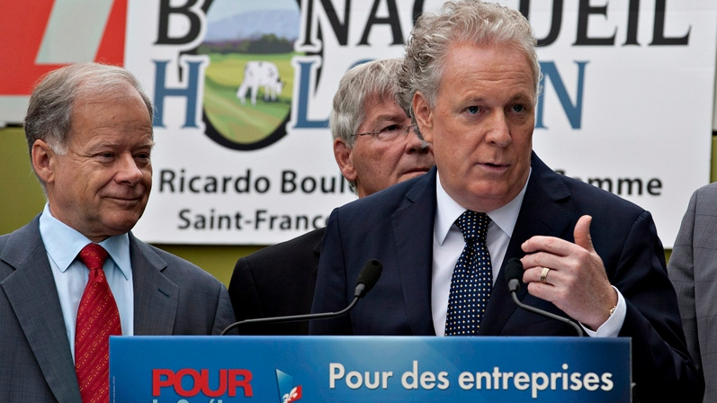Quebec Liberal Party Leader Jean Charest responds to questions at a news conference on a farm in Saint-François-de-la-Rivière-du-Sud Que., Monday, August 13, 2012. (Jacques Boissinot / THE CANADIAN PRESS)
