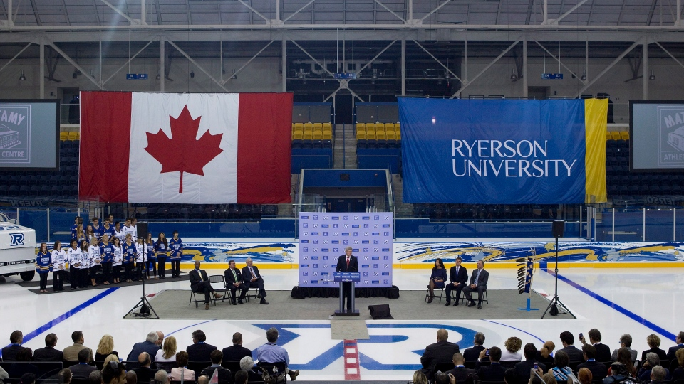 Prime Minister Stephen Harper stands at the podium as he addresses guests at Ryerson University's Mattamy Athletic Centre in Toronto on  August 13, 2012. The Prime Minister was joined by Finance Minister Jim Flaherty as the ice at the former Maple Leaf Gardens was illuminated for the first time. (The Canadian Press/Chris Young)
