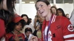 Canadian Olympic women's soccer player Diana Matheson signs autographs as she arrives home at Pearson airport in Toronto on Monday, August 13, 2012. Matheson scored the game winning goal in the women's soccer bronze medal match. (J.P. Moczulski/THE CANADIAN PRESS)