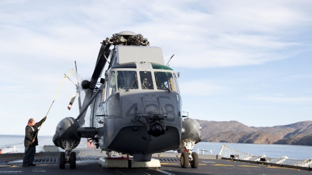 Crew members hose down a Sea King helicopter following a flight on the HMCS Toronto Wednesday August 19, 2009. (Adrian Wyld/TCPI/The Canadian Press)