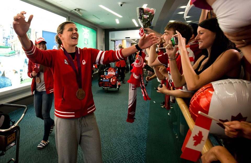 Canadian women's soccer team captain and London Olympics bronze medalist Christine Sinclair is greeted by family and friends upon arrival from London at Vancouver International Airport in Richmond, B.C., on Monday, Aug. 13, 2012. (Darryl Dyck / THE CANADIAN PRESS)