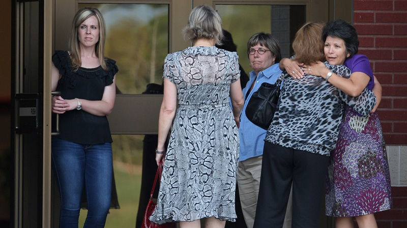 Family and friends of Constable Brian Bachmann arrive at Christ United Methodist Church for a vigil following a shooting that left three people dead, including Constable Bachmann near the Texas A&M campus in College Station, Texas on Monday, Aug. 13, 2012. (AP / Houston Chronicle, Karen Warren)